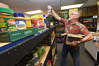 NWA Democrat-Gazette/FLIP PUTTHOFF <br /> GROCERIES TO GO<br /> Richard Booth works Tuesday July 9 2019 at the Grace United Methodist Church food pantry in Rogers. Free food and personal hygeine items are available on Tuesdays and Thursdays from 9 to 11:45 a.m. at the church, located at 1801 S. Dixieland Road.