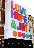 A giant four storey tall outdoor art installation, with the words of Love, Hope & Joy emblazoned across a building overlooking the Covent Garden Piazza, welcoming Londoners back to the city after the Covid-19 lockdown. Typography Artist Anthony Burrill was commissioned by Covent Garden. July 4th 2020<br /> <br /> Photo by Keith Mayhew
