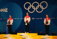 Aug. 8, 2008; Beijing, CHINA; Gold medal winner Mariel Zagunis (center) with silver medal winner Sada Jacobson (left) and bronze medal winner Becca Ward following the United States sweep of the womens fencing individual final at the 2008 Beijing Olympic Games at the National Stadium. Mandatory Credit: Mark J. Rebilas-