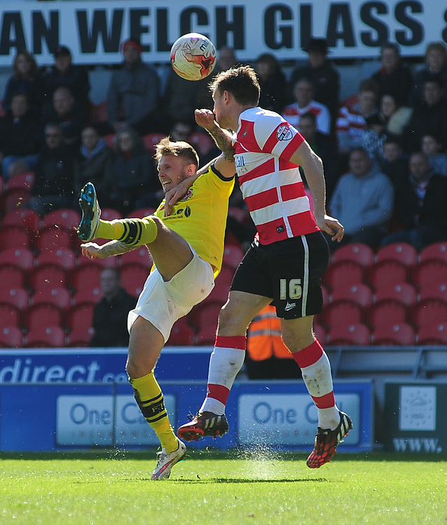Fleetwood Town's David Ball vies for possession with Doncaster Rovers' Andrew Butler<br /> <br /> Photographer Chris Vaughan/CameraSport<br /> <br /> Football - The Football League Sky Bet League One - Doncaster Rovers v Fleetwood Town - Saturday 18th April 2015 - Keepmoat Stadium - Doncaster<br /> <br /> &copy; CameraSport - 43 Linden Ave. Countesthorpe. Leicester. England. LE8 5PG - Tel: +44 (0) 116 277 4147 - admin@camerasport.com - www.camerasport.com