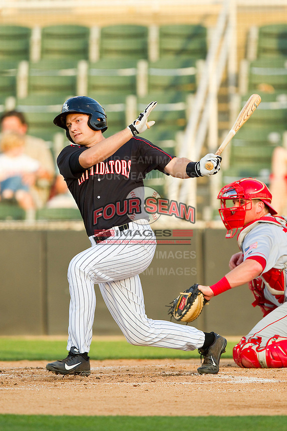 Jason Coats (17) of the Kannapolis Intimidators follows through on his swing against the Hagerstown Suns at CMC-Northeast Stadium on May 17, 2013 in Kannapolis, North Carolina.  The Suns defeated the Intimidators 9-7.   (Brian Westerholt/Four Seam Images)