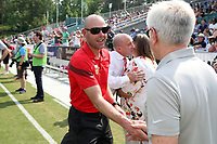 Cary, North Carolina  - Saturday April 29, 2017: Aaron Lines and Tom Sermanni during a pregame ceremony honoring the Western New York Flash for winning the 2016 NWSL championship prior to regular season National Women's Soccer League (NWSL) match between the North Carolina Courage and the Orlando Pride at Sahlen's Stadium at WakeMed Soccer Park.