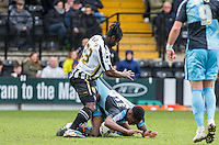 Stanley Aborah of Notts County attempts to lift Anthony Stewart of Wycombe Wanderers off the ball by his shirt during the Sky Bet League 2 match between Notts County and Wycombe Wanderers at Meadow Lane, Nottingham, England on 28 March 2016. Photo by Andy Rowland.