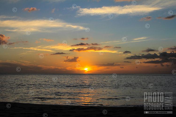 Colorful sunset at Makua Beach, Waianae, O'ahu.