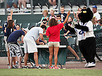 Fort Worth Cats Mascot, Dodger, watches some fans eat some hot wings during the American Association of Independant Professional Baseball game between the Amarillo Sox and the Fort Worth Cats at the historic LaGrave Baseball Field in Fort Worth, Tx. Fort Worth defeats Amarillo 3 to 0......