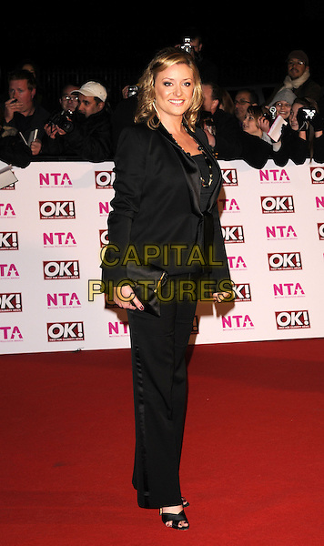LAURIE BRETT .arriving at the National Television Awards held at the Royal Albert Hall,  London, England, 29th October 2008..red carpet arrivals full length black suit jacket trousers clutch bag.CAP/FIN.©Steve Finn/Capital Pictures
