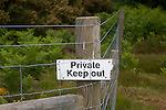 Private Keep Out sign on fence, Sutton, Suffolk, England