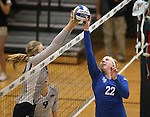 Nevada's Sam Willoughby and Air Force's Taylor Parker compete in a college volleyball match in Reno, Nev., on Thursday, Sept. 25, 2014. Air Force won 3-2.<br /> Photo by Cathleen Allison