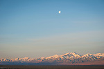 Waxing moon setting above the snow-covered Toyabe Range from Spencer Hot Springs, Nev.