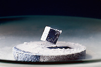 SUPERCONDUCTOR: MEISSNER EFFECT<br /> Diamagnetism Created With Liquid Nitrogen<br /> Liquid nitrogen brings ceramic disc formulated from the oxides of Yttrium, Barium, and Copper (YBa2Cu3O7) to its superconducting diamagnetic state preventing any magnetic field from entering it, which causes the small magnet to levitate.
