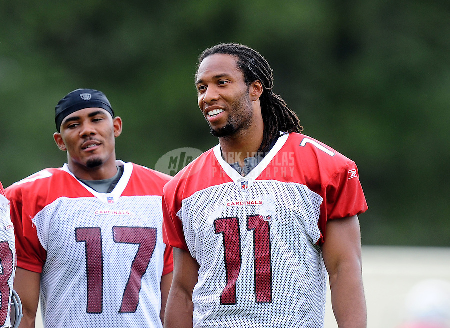 Jul. 31, 2010; Flagstaff, AZ, USA; Arizona Cardinals wide receiver (11) Larry Fitzgerald and wide receiver (17) Onrea Jones during training camp on the campus of Northern Arizona University. Mandatory Credit: Mark J. Rebilas-