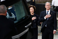 Former President George W. Bush and Laura Bush watch as the flag-draped casket of former President George H.W. Bush is carried by a joint services military honor guard to a State Funeral at the National Cathedral, Wednesday, Dec. 5, 2018, in Washington. <br /> CAP/MPI/RS<br /> &copy;RS/MPI/Capital Pictures