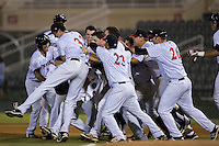 The Kannapolis Intimidators mob Grant Massey after his walk-off single in the bottom of the tenth inning defeated the Asheville tourists at Intimidators Stadium on May 28, 2016 in Kannapolis, North Carolina.  The Intimidators defeated the Tourists 5-4 in 10 innings.  (Brian Westerholt/Four Seam Images)