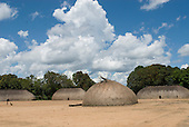 Xingu Indigenous Park, Mato Grosso State, Brazil. Aldeia Kamaiura. Village of traditional oca thatched houses.