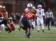 College Park, MD - November 25, 2017: Maryland Terrapins defensive back Antwaine Richardson (20) tackles Penn State Nittany Lions wide receiver Brandon Polk (10) during game between Penn St and Maryland at  Capital One Field at Maryland Stadium in College Park, MD.  (Photo by Elliott Brown/Media Images International)