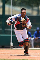 GCL Braves catcher Alejandro Flores (50) backs up a play during a game against the GCL Blue Jays on June 27, 2014 at the ESPN Wide World of Sports in Orlando, Florida.  GCL Braves defeated GCL Blue Jays 10-9.  (Mike Janes/Four Seam Images)