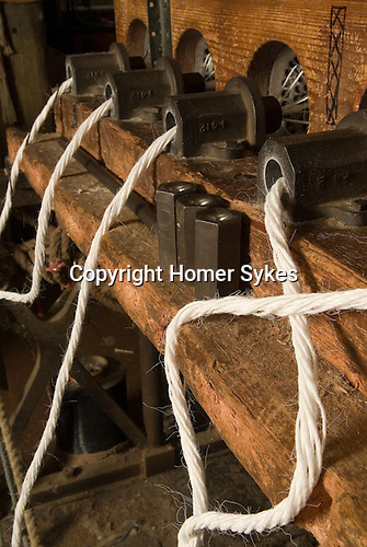 Mark Smith is Ropier at The Historic Dockyard Chatham Kent. Rope being fed through the registration plates and then 'forming tubes' to become 2.25 inch diameter rope.