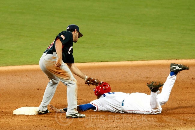 USA's Brian Barden tags out Cuba's Yuliesky Gourriel at second base during the semifinals game at the Wukesong Baseball Field in Beijing, Friday, August 22, 2008.  Cuba won the game 10-2..Chris Detrick/The Salt Lake Tribune.