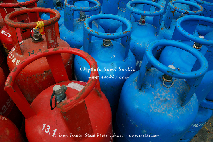 Rows of blue and red domestic gas bottles, Maldives.