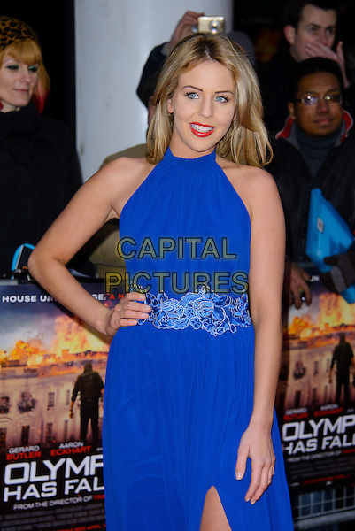 Lydia Rose Bright.The UK premiere of 'Olympus Has Fallen', BFI Imax, London, England..3rd April 2013.half length  blue sleeveless dress hand on hip lace detail waist .CAP/CJ.©Chris Joseph/Capital Pictures.