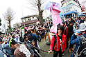 A man takes a selfie with a huge pink phallus during the Kanamara Festival in Kawasaki on April 3, 2016, Kanagawa, Japan. The Kanamara Matsuri or Festival of the Steel Phallus is held on the first Sunday of April at the Kanayama shrine. The shrine celebrates a legend of a steel penis and was frequented by prostitutes who wished to pray for protection from sexually transmitted diseases. Visitors now wish for easy delivery, marriage and matrimonial harmony. Because of the large steel phallus the unusual festival has become a tourist attraction attracting many overseas visitors and is used to raise money for HIV charities. Phallus shaped candy, carved vegetables, decorations, and a big parade are all part of the festival. (Photo by Rodrigo Reyes Marin/AFLO)