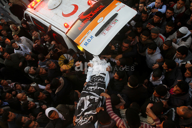 Palestinian carry the body of Zuhair al-Qaissi, a commander of the armed wing of the Popular Resistance Committees (PRC) in Gaza City, Friday, March 9, 2012. An Israeli airstrike killed top Palestinian militant commander Zuhair al-Qaissi and a second militant in Gaza on Friday in the highest profile attack against the coastal strip in months. Photo by Ashraf Amra
