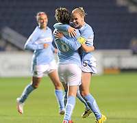 # 5 Lindsay Tarpley  of the Chicago Red Stars celebrates with teammate # 8 Megan Rapinoe after scoring the game winning goal against   the Washington Freedom. The Red Stars won the game 2-1