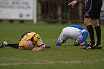 Wealdstone 0 Newport County 0, 17/03/2012. St Georges Stadium, FA Trophy Semi Final. Two players lying injured on the pitch at St Georges Stadium, home ground of Wealdstone FC, as the club played host to Newport County (yellow) in the semi-final second leg of the F.A. Trophy. The game ended in a goalless draw, watched by a capacity crowd of 2,092 which meant the visitors from Wales progressed by three goals to one to the competition's final at Wembley, where they would meet York City. The F.A. Trophy was the premier cup competition for non-League clubs in England and Wales affiliated to the Football Association. Photo by Colin McPherson.