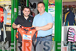 PRESENTATION: Mike Cronin of Green Heat and Pluming in conjuction with Kieran Casey Pluming presented Kieran Casey chairman of the Ballyheigue juvenilles with a set of Jerseys at Hennebreys Sport Shop, Ashe Street, Tralee..