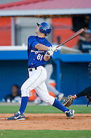 Jacob Kuebler #61 of the Burlington Royals follows through on his swing versus the Pulaski Mariners at Burlington Athletic Park August 4, 2009 in Burlington, North Carolina. (Photo by Brian Westerholt / Four Seam Images)