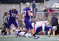 Jacob Eason fumbles in the first half, one of his three crucial turnovers.