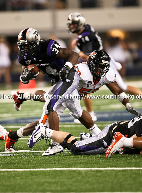 TCU Horned Frogs running back Ed Wesley #34 in action during the game between the Oregon State Beavers and the TCU Horned Frogs at the Cowboy Stadium in Arlington,Texas. TCU defeated Oregon State 30-21.