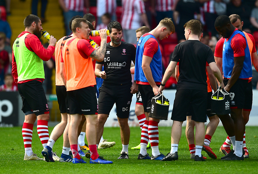 Lincoln City manager Danny Cowley, centre, during the pre-match warm-up<br /> <br /> Photographer Andrew Vaughan/CameraSport<br /> <br /> The EFL Sky Bet League Two - Lincoln City v Tranmere Rovers - Monday 22nd April 2019 - Sincil Bank - Lincoln<br /> <br /> World Copyright © 2019 CameraSport. All rights reserved. 43 Linden Ave. Countesthorpe. Leicester. England. LE8 5PG - Tel: +44 (0) 116 277 4147 - admin@camerasport.com - www.camerasport.com