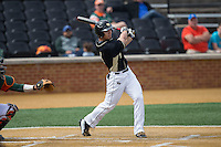 Stuart Fairchild (4) of the Wake Forest Demon Deacons follows through on his swing against the Miami Hurricanes at Wake Forest Baseball Park on March 22, 2015 in Winston-Salem, North Carolina.  The Demon Deacons defeated the Hurricanes 10-4.  (Brian Westerholt/Four Seam Images)