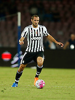 Juventus'Giorgio Chiellini controls the ball during the  italian serie a soccer match against    SSc,    at  the San  Paolo   stadium in Naples  Italy , September 26 , 2015