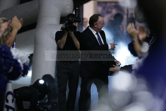 University of Kentucky's new head football coach, Mark Stoops, makes his way to the conference table at during the Live Press Conference held at the Nutter Training Facility in Lexington, KY on Sunday December 2nd, 2012. Photo by Kirsten Holliday | Staff