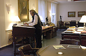 United States Secretary of Defense Donald H. Rumsfeld works at his desk and talks on the phone while in his office at the Pentagon in Washington, DC on September 11, 2003.  <br /> Mandatory Credit: Andy Dunaway / DoD via CNP