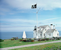 The 'skull and crossbones' flies from the flagpole above the lighthouse