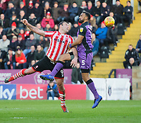 Lincoln City's Matt Rhead vies for possession with Port Vale's Leon Legge<br /> <br /> Photographer Chris Vaughan/CameraSport<br /> <br /> The EFL Sky Bet League Two - Lincoln City v Port Vale - Tuesday 1st January 2019 - Sincil Bank - Lincoln<br /> <br /> World Copyright &copy; 2019 CameraSport. All rights reserved. 43 Linden Ave. Countesthorpe. Leicester. England. LE8 5PG - Tel: +44 (0) 116 277 4147 - admin@camerasport.com - www.camerasport.com