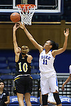 05 November 2015: Duke's Azura Stevens (11) blocks a shot by Pfeiffer's Safia Sheikh (DEN) (10). The Duke University Blue Devils hosted the Pfeiffer University Falcons at Cameron Indoor Stadium in Durham, North Carolina in a 2015-16 NCAA Women's Basketball Exhibition game. Duke won the game 113-36.