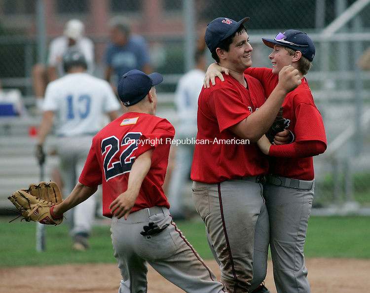 WATERTOWN, CT -22 July 2005- 072205BZ08- Wolcott #39, Craig Hassinger, center, gets congratulated on the win after defeating Bridgeport during the championship round of the Mickey Mantle Tournament Friday evening. <br /> Jamison C. Bazinet photo