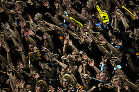 18 September 08: Colorado fans, dressed in nearly all black, cheers for the Buffaloes during a game against West Virginia. The Colorado Buffaloes defeated the West Virginia Mountaineers 17-14 in overtime at Folsom Field in Boulder, Colorado. For Editorial Use Only.