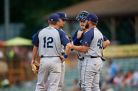 Brooklyn Cyclones pitching coach Royce Ring (40) in a mound visit with starting pitcher Jose Butto (30), third baseman Chandler Avant (12) and catcher Nick Meyer (26) during a game against the Tri-City ValleyCats on August 21, 2018 at Joseph L. Bruno Stadium in Troy, New York.  Tri-City defeated Brooklyn 5-2.  (Mike Janes/Four Seam Images)