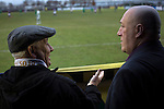 City of Liverpool 6 Holker Old Boys 1, 10/12/2016. Delta Taxis Stadium, North West Counties League Division One. Two home supporters chatting during the first-half at the Delta Taxis Stadium, Bootle, Merseyside as City of Liverpool hosted Holker Old Boys in a North West Counties League division one match. Founded in 2015, and aiming to be the premier non-League club in Liverpool, City were admitted to the League at the start of the 2016-17 season and were using Bootle FC's ground for home matches. A 6-1 victory over their visitors took 'the Purps' to the top of the division, in a match watched by 483 spectators. Photo by Colin McPherson.
