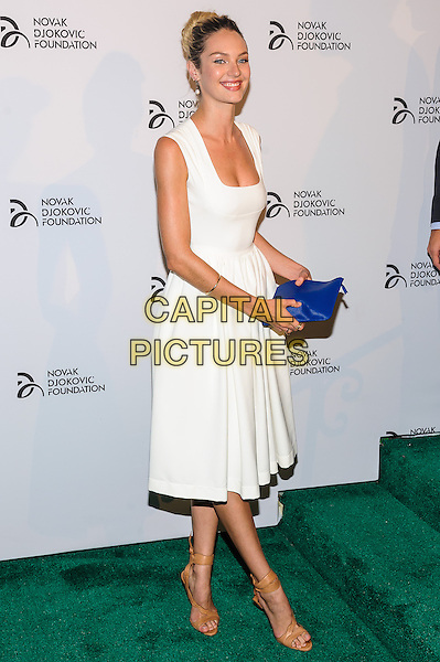 Candice Swanepoel<br /> Novak Djokovic Foundation Benefit Dinner, New York, New York, USA.<br /> September 10th, 2013<br /> full length dress white blue clutch bag<br /> CAP/ADM/MSA<br /> &copy;Mario Santoro/AdMedia/Capital Pictures