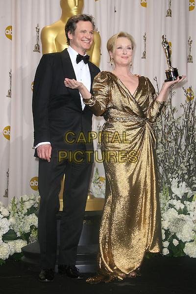Colin Firth & Meryl Streep.84th Annual Academy Awards held at the Hollywood & Highland Center, Hollywood, California, USA..February 26th, 2012.oscars full length gold dress award trophy winner black tuxedo  .CAP/ADM.©AdMedia/Capital Pictures.