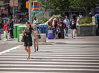 "A pedestrian using her smartphone crosses West 96th Street at Broadway in New York on Monday, August 4, 2014. As part of Mayor Bill de Blasio's ""Vision Zero"" initiative the speed limit of 30 mph has been reduced to 25 mph. Broadway from West 59th Street to West 220 Street has been posted as a ""Slow Zone"". with the other ""Slow Zone"" starting today atSouthern Blvd. in the Bronx. Two dozen zones will be instituted in the five boroughs over the course of several months. 22 pedestrians have been killed since 2008 in the Broadway ""Slow Zone"" and speeding is the top cause of traffic injuries and fatalities.   (© Richard B. Levine)"
