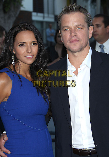 Luciana Barroso, Matt Damon<br /> &quot;Elysium&quot; Los Angeles Premiere held at the Regency Village Theatre, Westwood, California, UK,<br /> 7th August 2013.<br /> half length married couple husband wife blue dress arm around navy suit white shirt <br /> CAP/ADM/RE<br /> &copy;Russ Elliot/AdMedia/Capital Pictures