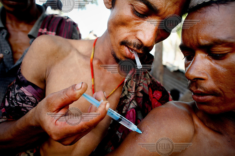 A drug addict has his drug injected. Drug addiction is a major social evil among young people in Bangladesh. One of the major causes is depression; people use drugs as a tool for removing their depression, but become addicted in the process.