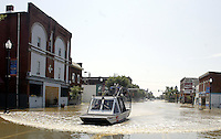 A United States Coast Guard airboat glides down Main Street as flood waters from the Blanchard River start to recede after heavy rains caused flooding Thursday, August 23, 2007, in Findlay, Ohio. The Blanchard River was close to 7 feet above flood stage at Findlay yesterday morning, the highest since a 1913 flood..
